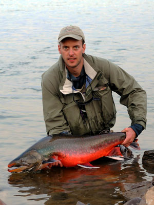 Nils with arctic char caught on Intruder - 102cm and 12.5kg